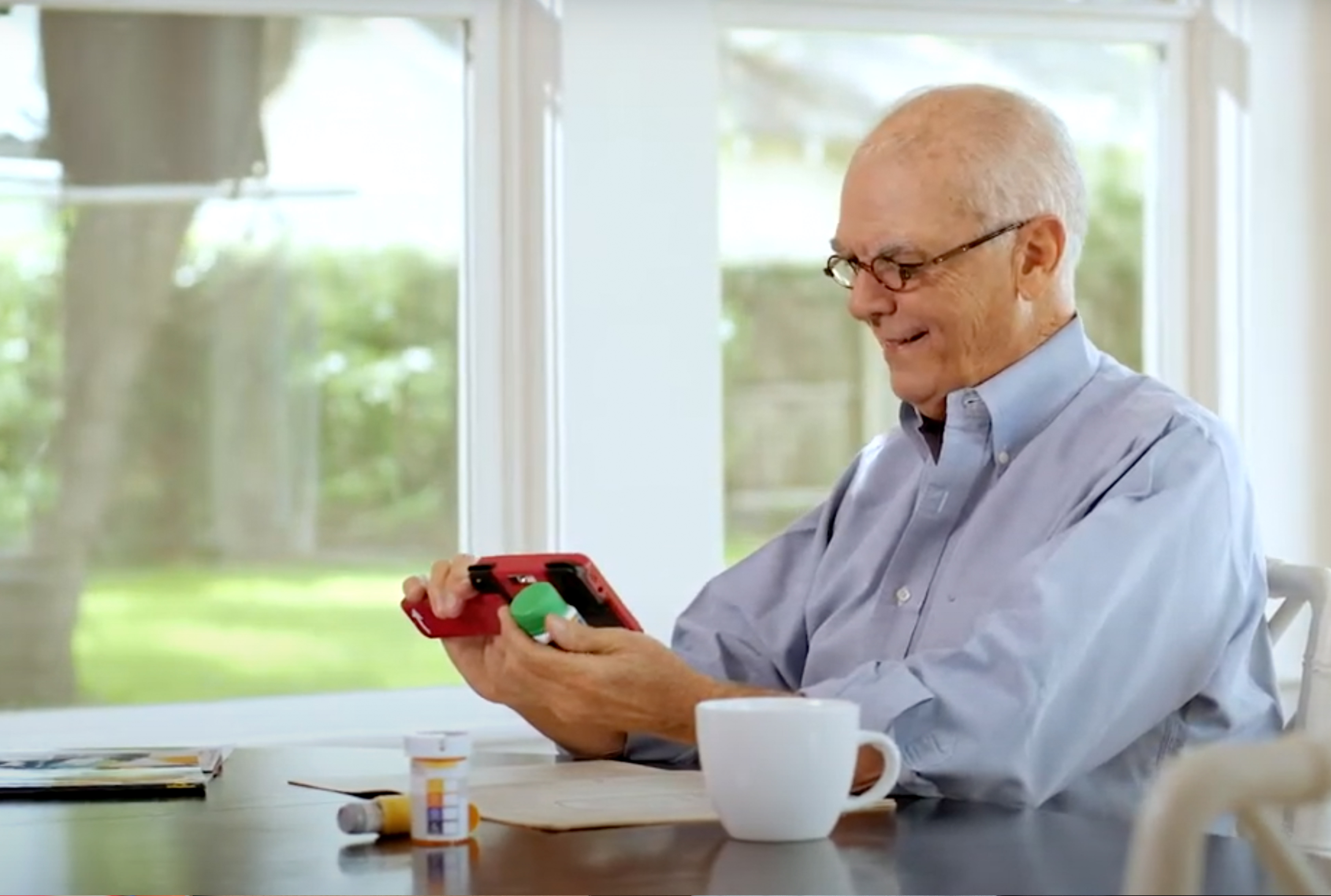 man using RUBY XL HD to read medication at home