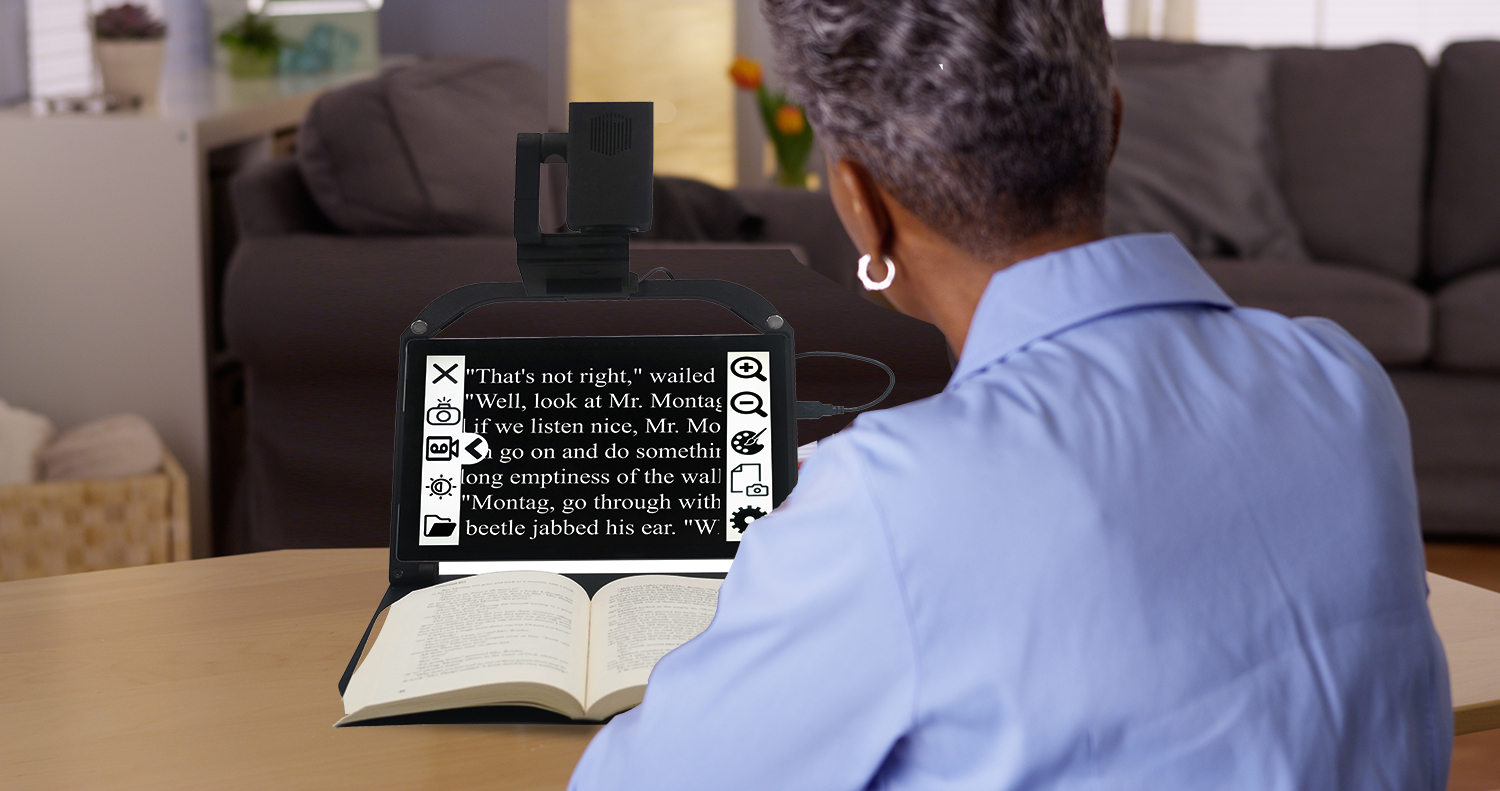 Senior woman using ONYX PRO to read a book